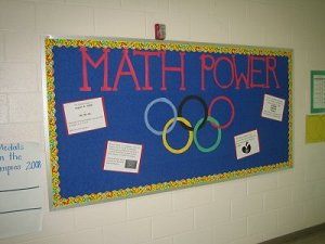 Picture of a bulletin board with a head of Math Power