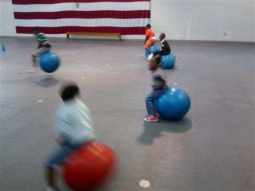 Children bouncing to practice landing on two feet
