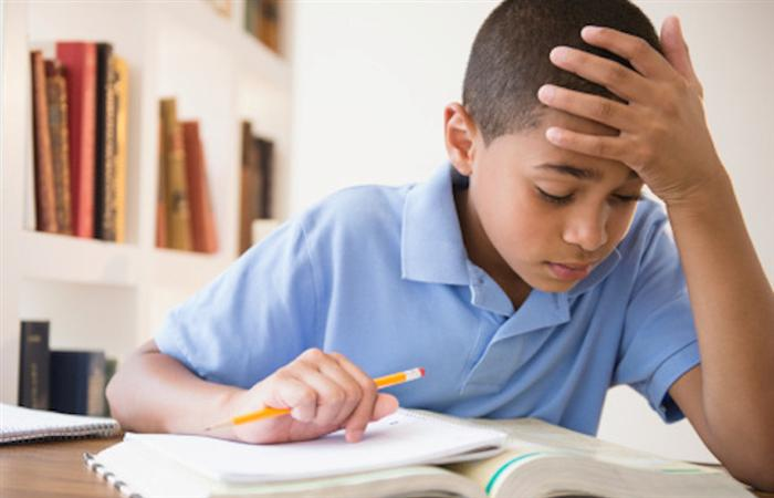homework help image of boy struggling with homework